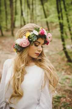 Long wedding hair always looks fantastic with a floral crown.