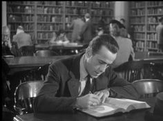 """Library scene with Humphrey Bogart in the classic film """"The Big Sleep"""" (1946)."""