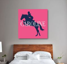 Is riding horses your life?  If so, this personalized canvas will look great in your bedroom or dorm room.  You can customize it with any colors from our palette or order it in the bubble gum pink, navy blue and white shown.  We will personalize this preppy canvas with your name.  Perfect for any girl or teens equestrian themed room.