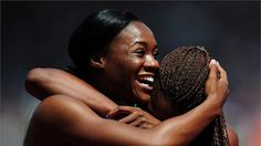 Marlena Wesh of Haiti (L) smiles after competing in the Women's 400m Heats on Day 7 of the London 2012 Olympic Games at Olympic Stadium