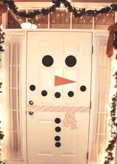Turn a white door into a snowman.