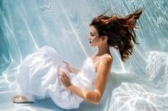 sure, i'll sit on the bottom of the pool in my wedding dress...did you say smile???