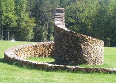 Cord wood spiral, Woodstock, Vermont by Ken Woodhead, 12 feet high at center.