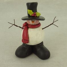 Add this adorable smiling snowman to any spot in your home; he'll bring a little joy to everyone who sees him.