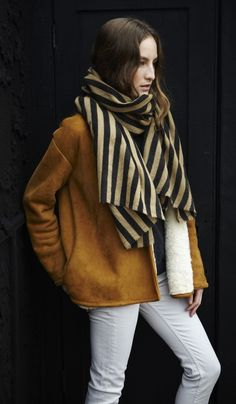 You can still rock your white denim in fall -- just pair with dark colors and chunky knits!
