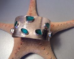 English seaglass cuff - 7 teal/torquoise color bezel seaglass treasures on Sterling silver cuff by Caribbeanmemories on Etsy https://www.etsy.com/listing/217615074/english-seaglass-cuff-7-tealtorquoise