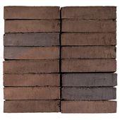 Grå, sorte og brune mursten