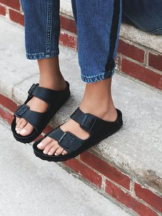 Monterey Exquisite Birkenstock | In a modern and monochromatic design, these chic all leather Birkenstocks are handcrafted with a smooth footbed and matching matte buckles. The traditional, fully adjustable two-strap detail has been updated and placed further back to offer a bit more coverage. Textured rubber soles.