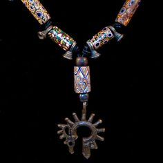 African trade bead necklace with Dayak pendant