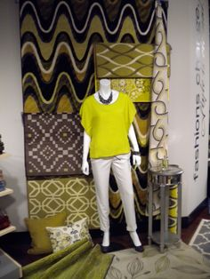 showrooms are used to display products such as clothing, accessories, cars, fabrics and furniture. This is a picture of a New York show room displaying the trending patterns and colors for the season.
