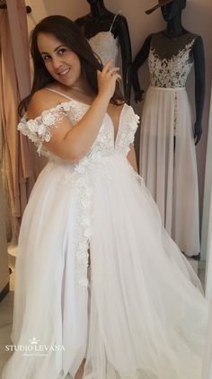 Real bride in a plus size princess tulle ball gown with slit and off  shoulder straps 769b8bcb762b