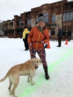 Spectator and her pup at Steamboat Springs Winter Carnival © 2017 Skijor International, LLC