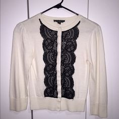 Cream Sweater with Black Lace Detail Beautiful, three quarter length sweater with black lace on the front. Can be dressed up or down. Snap closure. I've only worn it once, so no flaws! Behnaz Sarafpour Sweaters Cardigans