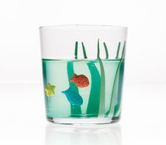 Fun to eat for a kids' party!  Small green gelatin aquarium with sea grass and colored candy fish