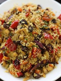 An exotic and colourful Moroccan Couscous  with chickpeas, roasted red peppers, diced carrots, toasted almonds and plump raisins are...