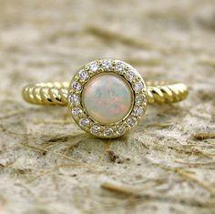 Opal, Diamonds, and Gold Ring.