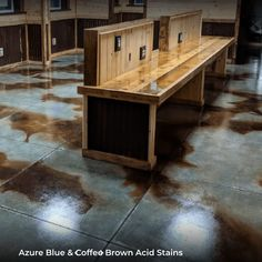 """""""Wet on dry marbling effect"""" using Azure Blue Acid Stains as the """"dry"""" base color and coffee brown accents. This concrete floor design was sealed with a High-Gloss Acrylic Sealer."""