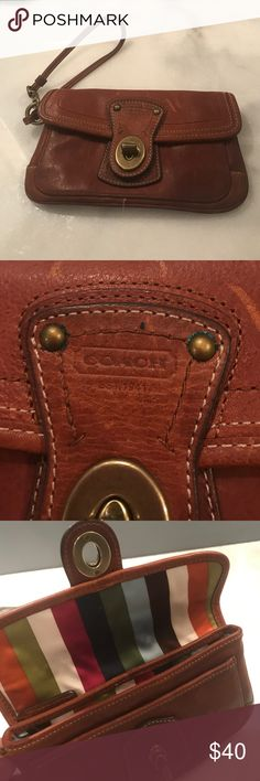 "Coach brown leather wristlet Coach brown leather wristlet. A few Scratches on leather. 7""x 4.5"" Coach Bags Clutches & Wristlets"