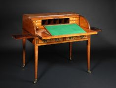 An important late 18th Century Sheraton period satinwood Cylinder Bureau, having purple-heart cross-banding and box wood stringing throughout. The tambour shutter enclosing well fitted interior and pull-out writing slide. The desk having two frieze drawers fitted with original brass handles ending on square tapering legs with brass castors.