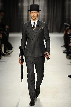 This autumn I need to invest in a high-buttoning, fitted double breasted suit.....love it.