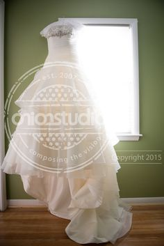 Detail photography of a-line wedding gown with ruffled train by Robyn Buyskes of Onion Studio, Inc. Wedding took place at Pearl Street in Buffalo, NY.