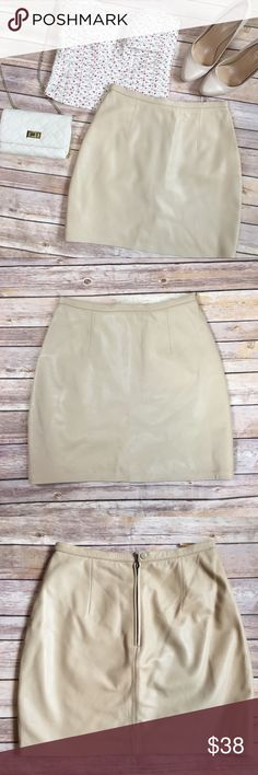 Wilsons Leather Beige Mini Skirt Very cute leather skirt, sits above naval & fitted thru hips. Wear with a crop top for summer or long sleeve sweater for a polished winter look, perfect for all seasons! Outer shell is 100% leather and lining is 100% polyester. Back zipper and single button closure. Skirt length is approximately 16 1/2 inches, waist corner to corner is approximately 13. Excellent used condition, no major flaws noted. Color is a warm beige. Wilsons Leather Skirts Mini
