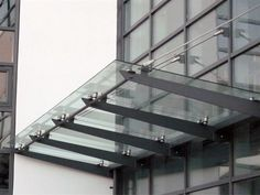 The canopy was manufactured from mild steel components with stainless steel tension rods and planr type fittings throughout. A rear gutter channel completed the design