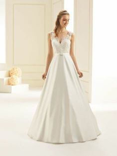 A-Line Bridal Dress made of high quality lace and satin fine satin belt with a small bow with a V-neckline decorative row of back buttons with discrete back-zip fastening with train non-slip elastic strap to hold in place. Dress Silhouette, Dress Making, Bridal Dresses, Classic Style, Neckline, Satin, Bows, Lace, Fashion
