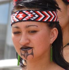Maori woman with traditional ta moko