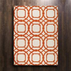 A Moroccan-inspired geometric pattern in shades of orange pops against the ivory background of the Arabesque wool rug. Make a global statement in any room with this graphic, hand-tufted floor covering.