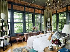 The Lakehouse - lake house on the shores of Upper Saranac Lake in New York's Adirondack Mountains. Designed by architecture firm Shope Reno Wharton, with interiors by Thom Filicia