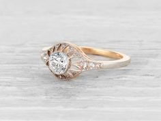Antique Edwardian engagement ring made in 18K yellow gold and platinum and centered with a GIA certified .48 carat G color SI2 clarity old European cut diamond. Accented by 16 single cut diamonds. Circa 1910