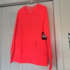 Nike Women's Large Thermafit Pullover Front pocket, gorgeous vibrant salmon, size large, long sleeve, front pocket, NWT. Nike Tops Sweatshirts & Hoodies
