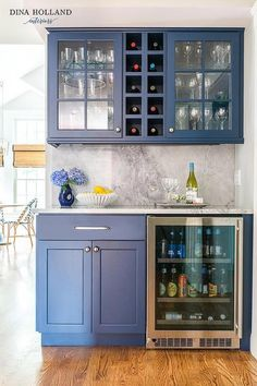 Glass front blue cabinets flank built-in wine shelves fixed above a dark gray marble slab backsplash lining a dark gray marble countertop. Blue Cabinets, Diy Cabinets, Kitchen Cabinets, Kitchen Bar Counter, Glass Cabinets, Upper Cabinets, Bar Interior, Bar Furniture, Kitchen Furniture
