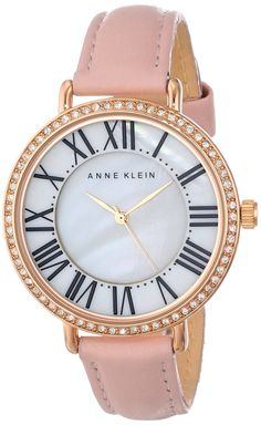 Anne Klein Women's AK/1616RGLP Watch with Swarovski Crystals and Leather Band. Round watch with Swarovski crystal-set bezel and mother-of-pearl dial. Japanese quartz movement with analog display. Protective mineral crystal dial window. Features buckle closure, roman numeral markers, and leather strap. Water resistant to 99 feet (30 M): withstands rain and splashes of water, but not showering or submersion.