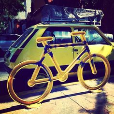 Coordination is key. #yellow #bicycle #tinyyellowcar