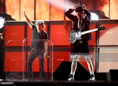 News Photo : Singer Brian Johnson and guitarist Angus Young of...