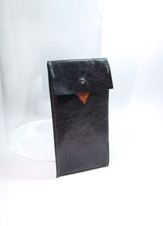 iPhone 5 leather sleeve in shiny navy  / iPhone case / origami pouch with orange diamond appliqué. £29.00, via Etsy.