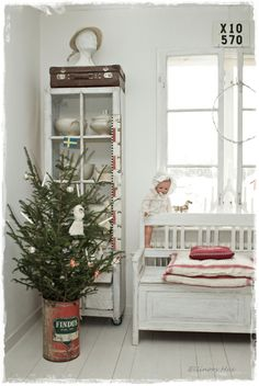 I like the tall skinny display cabinet as well as the tree in the rusty red metal can