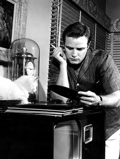 Marlon Brando at home with his cat Olé, early-1950s.