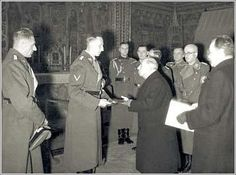Dr. Emil Hacha -right- believed only full subordination to Heydrich would ensure the existence of the Czech Nation