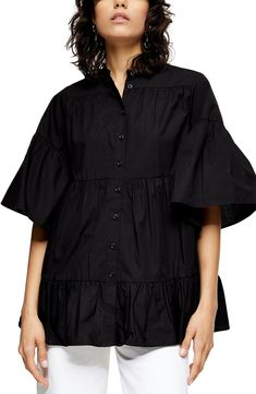 Flouncy sleeves frame this crisp poplin shirt design with floaty tiered ruffles and a roomy fit. Style Name:Topshop Tiered Poplin Blouse. Style Number: 6097464. Available in stores.