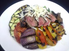 It was everything but the kitchen sink for Monday's lunch! Backyard Steak Salad with Grilled Vegetables (eggplant, zuchinni, tomato, peppers, mushroom, onion), Balsamic Greens  Mozzarella Cheese.