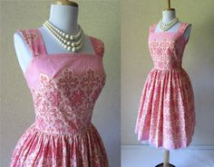 This 1950s pink sundress is perfect for an afternoon luncheon at the club.