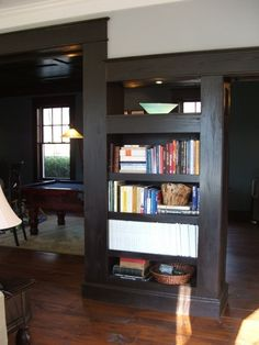 making a load bearing wall an open space and a usable space...I love it!