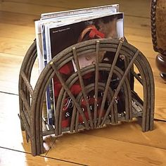 Amazing DIY Magazine Holders Ideas - Mostly people feel annoyed about newspapers and magazines being spread all over the place in office or at home. Willow Furniture, Fairy Garden Furniture, Rustic Furniture, Furniture Decor, Natural Furniture, Diy Magazine Holder, Magazine Rack, Rustic Wood Crafts, Sticks Furniture