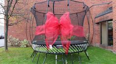 For an extra touch wrap the ribbon around your trampoline net.  Use wire to attach either end of the ribbon to the center of your bow once it's wrapped around the net.