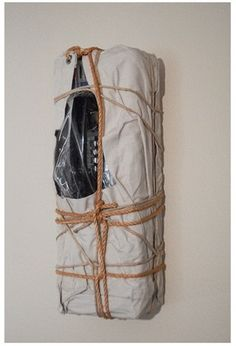 Wrapped New York Payphone by Christo and Jeanne-Claude. Steel payphone wrapped in canvas, polyethylene, twine and rope 1988