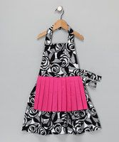 With a pleated overskirt, this apron is the epitome of retro-chic. It has a Velcro closure at the neck and it ties closed at the waist for a perfect fit.12'' W x 26'' H100% cottonMachine washImported