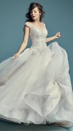 Maggie Sottero - EDEN, This princess wedding dress features a bodice of beaded lace motifs accented in Swarovski crystals, trailing into a ballgown skirt comprised of tulle.